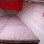 There's a 6 foot double bunk in the forepeak, with sail storage beneath